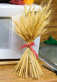 wheat stalks tied in a bow to make decor for country theme