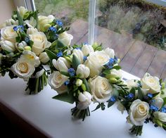 https://flic.kr/p/r7gpu8 | Blue and white bouquets | Bouquet of white roses, tulips and forget me nots by The Flowersmiths, wedding florist in Kent