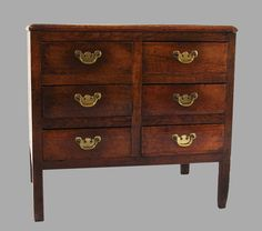 "An English provincial elm 6 drawer chest of small size, circa 1780. Fine color and patina.  H. 24.5"" W. 26.25"" D. 18"" C916-3 $2,850.00"