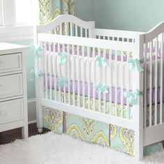Aqua and Amethyst Laval Crib Bedding | Carousel Designs. Stunning! What little girl wouldn't love the serene colors of aqua and amethyst to sooth themselves to sleep. These tranquil colors blend perfectly in our Aqua and Amethyst Laval crib bedding collection. The modern design paired with our fun Purple Dots fabric creates a one of a kind nursery for your precious one.