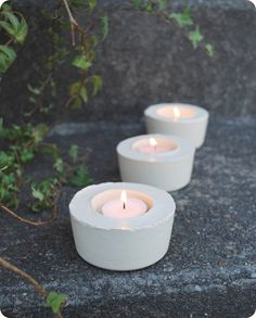 Cement Candleholders:  I love this idea. I feel safer having lit candles in a material like cement when they're outside. Especially if someone forgets to blow them out. The cement won't catch fire. Whew! :)