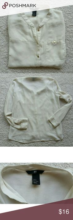 H & M Blouse Gorgeous ivory H & M button down blouse with gold buttons. 100% polyester, lower in the back. Comes with a replacement button H&M Tops Blouses