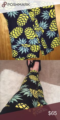 Pineapple leggings. •SUPER RARE HTF!• Gorgeous black and yellow pineapple leggings. OS. Fits 0-12. Worn once and washed per standards. Just like the fit of TC better so I'm selling these. Price is firm. Unicorns!  LuLaRoe Pants Leggings