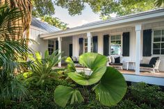 Beautiful Classic Key West home designed with the intent of providing separate areas between the main house & the guest house using the swimming pool to help create the feel of different spaces allowing for walkways from area to area. It was also important for the owners to feel as though they were in a clearing within a wooded area