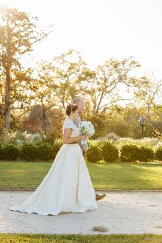 Wedding Gown by Amsale -- See the wedding on #SMP here - http://www.StyleMePretty.com/southeast-weddings/2014/04/08/rustic-elegance-plantation-wedding/ Photography: AndrewCebulka.com