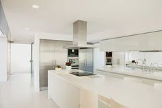 Here's a stark white contemporary kitchen design with super long island and a minimalist vibe. White Contemporary Kitchen, Contemporary Kitchen Cabinets, Kitchen Cabinets Decor, Kitchen Layout, Kitchen Countertops, Cabinet Decor, Kitchen Ideas, Kitchen Island, Blue Cabinets