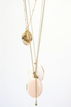 Chic French pendants on long gold chains. Perfect for the still-not-in-my-closet asymmetric LBD.
