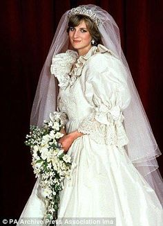 Princess Diana , the lovely bride on July 29,1981. She's looking so pretty and yet in this picture her shyness is reflected.    ~~Princess Diana's Dress Details: A 25-foot train accented Diana's ivory Emanuel gown, made of 40 yards of silk taffeta; five extra copies were made as backups. For good luck, a small diamond-studded gold horseshoe was sewn into her gown.
