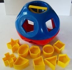 Have one...Mine was from Tupperware....match the shapes with the holes...my nephew, Korbin LOVES this...haha:)