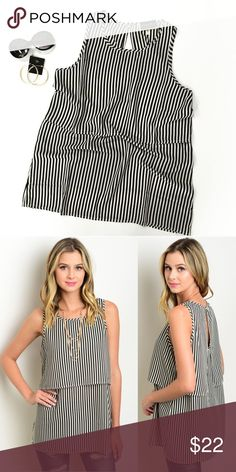 Striped two layer top Black and ivory striped two layer tank top. Polyester. 29 inches long.   Sizes: S (fits 2-4), M (fits 6-8), L (fits 10-12) Tops Blouses