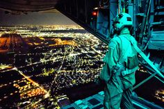U.S. Air Force Staff Sgt. Nickolas Alarcon, a loadmaster assigned to the 36th Airlift Squadron, observes a drop zone from the rear of a C-130 Hercules aircraft after deploying a light payload above Yokota Air Base, Japan, during a readiness week Feb. 21, 2013. (DoD photo by Osakabe Yasuo, U.S. Air Force/Released)130221-F-PM645-390 by U.S. Department of Defense Current Photos, via Flickr