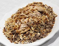 Lebanese Chicken and Rice 'Riz bi-Djaj' The most delicious arab food recipes. Lebanese Cuisine, Lebanese Recipes, Lebanese Dishes Recipe, Lebanese Chicken And Rice Recipe, Eastern Cuisine, Arabic Food, Arabic Dessert, Arabic Sweets, Middle Eastern Recipes