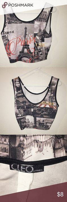 MAJOR SALE! 🎉❤️🙌🏻 LOOK NOW! EVERYTHING MUST GO! Black and white women's crop top with scoop neck and images of paris ideal for any style! This tank top style crop top is featuring a scoop neck line in both the front and back as well as the eye catching Eiffel tower. The tag is worn but this party shirt still has a lot of life! Making room for new inventory! Entire closet on sale!  Please offer or bundle! Tops Crop Tops