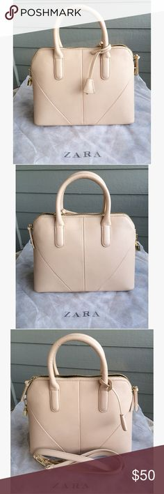 Zara Woman Mini City Satchel • Zara Woman mini city satchel bag • Super versatile taupe with gold hardware and a sleek black interior • One interior zippered side pocket  • Removable and adjustable cross-body strap • Comes in dust bag • Re-posh: worn only a couple times by previous owner, never by me (thanks to Harvey). Looking to recover cost, and pass this gorgeous bag onto a boss lady with incredible style!  • Dimensions: 12.5 inches long, 5 inches wide, 10 inches tall Zara Bags Satchels