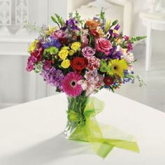 Featuring 21 varieties of flowers and every color of the rainbow, this sensational arrangement delivers an entire garden in one vase.