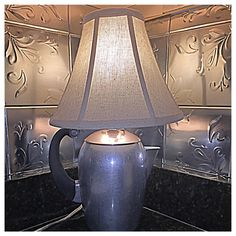 My husband made this kitchen counter lamp from an old percolator.