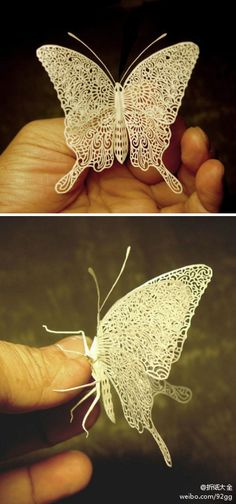 This paper butterfly is awesome. Enlarge the picture to see the intricate cutting details. WOW!