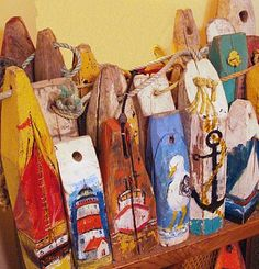 collection of vintage wooden lobster trap markers from Nova Scotia recently decorated with nautical scenes by Dorothy Hudgins.A collection of vintage wooden lobster trap markers from Nova Scotia recently decorated with nautical scenes by Dorothy Hudgins. Nautical Theme Decor, Nautical Design, Nautical Home, Nautical Style, Vintage Nautical Decor, Beach Design, Coastal Style, Coastal Decor, Painted Oars