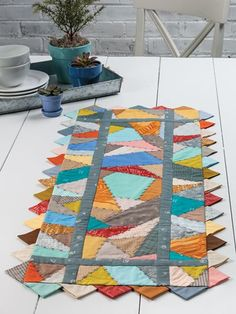 EXCLUSIVELY ANNIE'S QUILT DESIGNS: Run Like Crazy Quilt Pattern. Order here: https://www.anniescatalog.com/detail.html?prod_id=140867&cat_id=1644