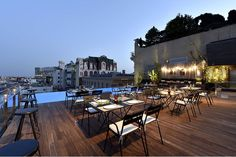 Relax on the rooftop of the Grand Hotel Central in Barcelona where you're guaranteed a sunbed by the infinity pool.