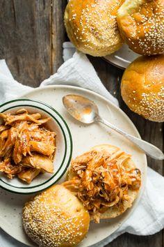 Slow cooker BBQ chicken sandwiches served in a soft brioche bun.: