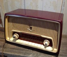 "We are diggin this near mint condition Grundig kitchen radio. Made in the 1950s and represented under the Canadian Fleetwood brand, Grundig is world renowned for its quality product. It is fully operational and generates a clear sound. Speaker cloth is in excellent condition, as is the maroon finish cabinet with gold trim. A fab statement in your home or office!  Dimensions: At base: 14"" x 7 7/8"" At top: 13"" x 5 ¾"" Height: 8 ¼""  Condition: We love searching for beautiful vintage and anti..."