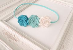 Might have to purchase for Lyla.  Baby Flower Headband  Felt Flower Headband Felt by SuperAdorable, $6.99