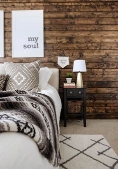 Decorated bedroom with a walnut stained DIY wood plank accent wall