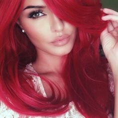 Gorgeous. Love the red hair and the makeup, plus she is beautiful.