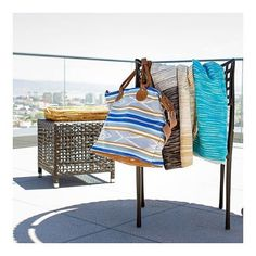 Patio goals.  (Learn more about how our chevron woven tray, Santorini weekender, and Lisbeth infinity scarf empower artisans and their communities worldwide at: malena.com)!