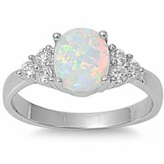 GORGEOUS White Australian Opal White CZ Ring Sizes A fashion Quality Fashion Ring for Ladies of all ages The perfect Gift for any occasion. The Lab Created Opal Fire and Sparkle can vary under different Types of LightingLab created Australian Opal Engagement Ring Sizes, Beautiful Engagement Rings, Engagement Jewelry, Opal Earrings, Opal Jewelry, Fine Jewelry, Jewellery Rings, Pretty Rings, Beautiful Rings