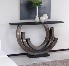 Contemporary console tables are essential to design pieces in any modern interior, a modern console table is a bright addition to a living or dining room. Entryway Table Modern, Modern Foyer, Entry Tables, Sofa Tables, Modern Sofa, Silver Console Table, Modern Console Tables, Hall Table Decor, Table Decorations