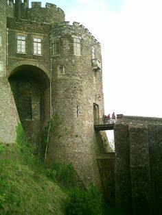 """Dover Castle is a medieval castle in Dover, Kent. It was founded in the 12th century and has been described as the """"Key to England"""" due to its defensive significance throughout history. the largest castle in England."""