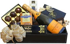 Send the perfect bottle of bubbly to toast the season with classic Veuve Clicquot a lovely balanced champagne with beautiful golden color. This simply classic gift is sent with indulgent rich chocolates.