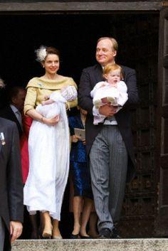 Prince Carlos of Bourbon-Parma and Princess Annemarie of Bourbon-Parma (L) with Princess Cecilia Bourbon-Parma (front L) and Princess Luisa of Bourbon-Parma leaving the christening of Dutch Princess Cecilia of Bourbon-Parma in the Cathredral of Piacenza, 5 April 2014.
