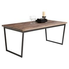 Solid walnut-topped dining table with a black steel base. Product: Dining tableConstruction Material: Solid wa...