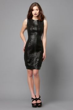 The Emeilia cocktail dress by George is a fitted sequined dress with leatherette panelling, also available in beige.