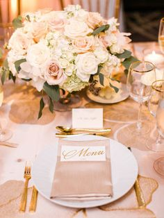 Photographed by Michael and Carina, this urban, glam Baltimore wedding was filled with blush and cream florals!