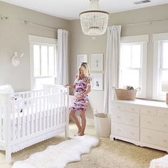 This sweet mama is all ready for baby! Loving this calm white nursery space and … This sweet mom is all ready for baby! I love this quiet white nursery and this Malibu chandelier! Beige Nursery, Girl Nursery, Girl Room, Nursery Room, Nursery Decor, Baby Room Colors, Baby Nursery Neutral, Calming Nursery, Baby Animal Nursery