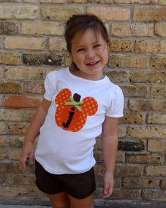 mickey pumpkin shirt. Could make a different one for each holiday