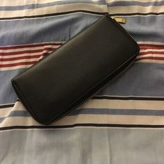 Black and gold leather wallet 7in wallet with change pocket inside. Gold zipper and all black inside. Like new! Will take offers Mossimo Supply Co Bags Wallets
