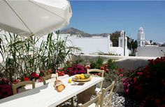 Al Fresco dining in a Greek veranda..  Mansion Sophia, Santorini