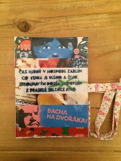 Handmade notebook with collage and fabric cover. For this notebook, I used my photographs of street art found on the walls of Prague, Czech republic. For sale on www.delphineiv.com