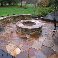 stone patio with hearth pit.... >> See more by going to the photo link
