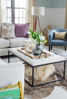 how to decorate with pops of color and great idea using a wooden tray to corral items on the ottoman coffee table.