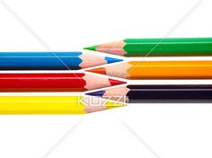 close-up shot of color crayons on white background. - Close-up cropped shot of color crayon pencils in front of each other on white background.