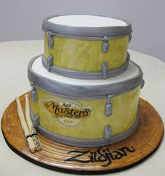 2 tier drum cake with symbol base
