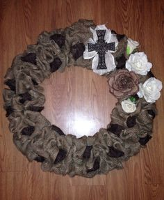 Natural burlap wreath with darker brown burlap with simple cross. I made this for my mom for Christmas. She loved it.