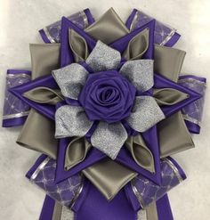 View our collection of ribbons and rosettes available in accents including floral, patterned, glittery golds, silvers and more. Craft Flowers, Flower Crafts, Ribbon Rosettes, Ribbons, Diy Ideas, Craft Ideas, Centaur, Purple Grey, Homecoming