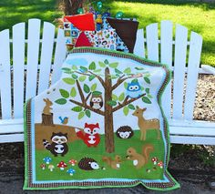 Soft, cuddly Forest Friends Baby Quilt and coordinating receiving blankets.